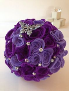 SALE ITEM - Handmade lilac and purple felt rose bouquet with crystal and pearl detailing and a butterfly brooch to finish. on Etsy, $67.17