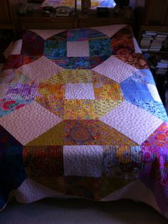 """""""Kaffe's Coins"""". A friend loved my quilt """"Japanese Coins"""", so my sister cut 2 tops out of my Kaffe Fassett stash, so that my friend and I could make almost identical quilts."""