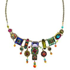 This stunning necklace displays Firefly's passion for color! Embellishing mixed shape elements with mosaics and the cut Swarovski crystals on antique silver tone setting, heirlooms are created. Hope, Wish, Spirit, Dream inspirational words on the back of the oblong crystal.. Firefly's signature intricately embellished mosaics designed by Juan Carlos Chavajay Vasquez and created by skilled artisans in the Guatemala workshop.