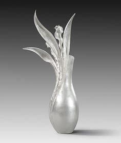 Rauni Higson - Asymmetric vase form, raised, with Fold-formed/Anticlastic formed rising element set in, bursting upwards. Weighted base for balance. In the Goldsmiths' Company Collection, commissioned 2012.