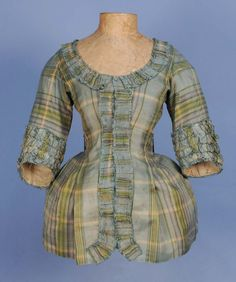 Pet-en-l'air jacket, 18th century. Pale blue, green, cream and purple silk plaid, self fabric trimming.