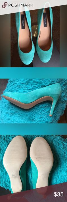 ANN TAYLOR AQUA PUMPS This pair of Ann Taylor pumps are basecally new had only walked on carpet not outside on the street as you can tell from picture #3. Beautiful aqua suede and upper leather great for the up caming summer days.Size 6m with 3 1/2 heel very confortable shoes. Shoes come with out box. One of the shoes has an indentation on the side made by the other pair of shoes but it's not visible when shoes is on Ann Taylor Shoes Heels