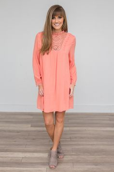 """Coral dress with bubble sleeves, a high neck, lace detail, and keyhole button back closure. Fully lined. Sleeves measure 21"""""""" from shoulder. Measurements from shoulder to hem: S-32"""""""", M-33"""""""", L-34""""""""."""