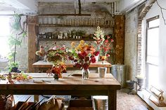 Glamor in Greenpoint: A Studio Visit with Florist Amy Merrick Gardenista Flower Studio, Piece A Vivre, Rustic Kitchen, Stone Kitchen, Back Home, Decoration, Interior And Exterior, Retail Interior, Beautiful Homes