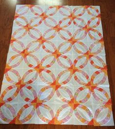 Pieced by me.  The quilt pattern is Metro Rings - Sew Kind of Wonderful.