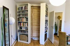 two Billy bookcases open up to reveal a DIY Murphy bed. Get all the details from IKEA Hackers. from Little Life Savers: Clever IKEA Hacks for Small Spaces Murphy-bett Ikea, Ikea Hack, Kallax Hack, Ikea Kallax, Cama Murphy, Ikea Billy Bookcase Hack, Billy Bookcases, Bookshelves Ikea, Dorm Room Storage