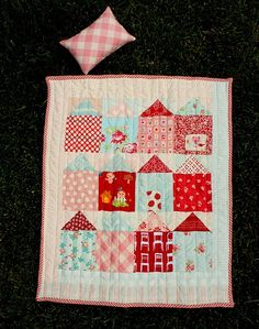 Could I adapt this doll quilt to one big enough for the daybed in the playroom? Would I lay the houses sideways?