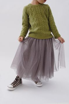 I LOVE this look! I've done it so many times - frilly, feminine skirt with big chunky sweater! Adore!!!! the   sabella   sweater @wunwaykids