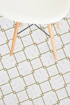 Fitzgerald is our Diamond Tile Marble Vinyl Flooring that is Art Deco inspired with gold lined diamond tiles and a sophisticated White Marble effect design with dainty grey veins.