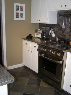 white cabinets, slate floors, mocha walls