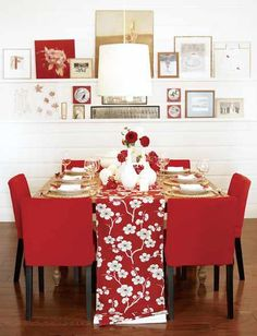 Make your guests hunger for your feast by using a red and white floral table runner and contemporary chairs upholstered in a slightly brighter cardinal color.