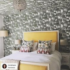 Don't be afraid of print! Go bold and take your décor to the next level with a unique twist. We love this Tropical bedroom using our @julienmacdonald Honolulu wallpaper not only on their wall but encapsulating the room by using it on the ceiling also  Honolulu Green Product Code - 32-969  #honolulu #palm #tropical #palmprint #designer #julienmacdonald #wallpaper
