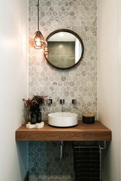 Maria opens the doors to her luxurious and contemporary home Stunning powder room with marble hexagon wall tiles, round mirror and copper pendant light As seen on season 1 of Decor Ideas That Make√ Small Bathroom Remo The Doors, Bad Inspiration, Bathroom Inspiration, Mirror Inspiration, Hexagon Wall Tiles, Honeycomb Tile, Hex Tile, Small Half Bathrooms, Bathroom Small