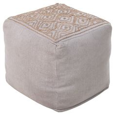 The perfect accent for your living room or master suite ensemble, this eye-catching pouf showcases diamond trellis embroidery in ash grey.     ...