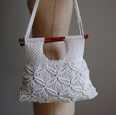 vintage 70s boho hobo hippie macrame purse in cream white color.wooden handles.braided double strap handles.fully lined with pocket.    tag: handmade in Philippines era: 1970s / 1980s  measurements:  13x11,strap 29 inches    condition:excellent!    shop more bags here:  http://etsy.me/1mCr5Fd