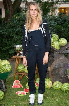 Cara Delevingne wears dark green dungarees on the hottest day of the year at the Club Monaco Garden Party