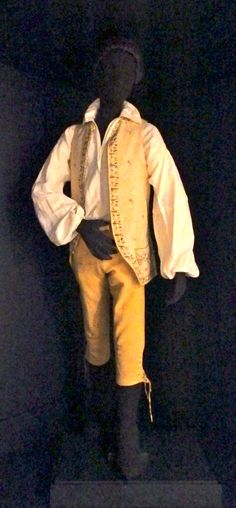 David Balfour from Kidnapped, by Robert Louis Stevenson, 1886, from Fashions in Fiction exhibit, Genesse Country Village & Museum, Mumford, NY. May 10, 2014 to Oct. 2015. 18th century breeches, ca. 1770 embroidered waistcoat and linen shirt. Reproduction dirk.