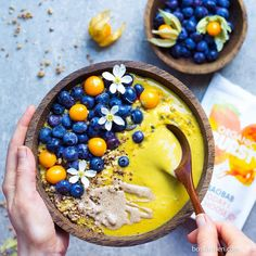 Sunshine smoothie bowl with turmeric and blueberries for an antioxidant power-punch.