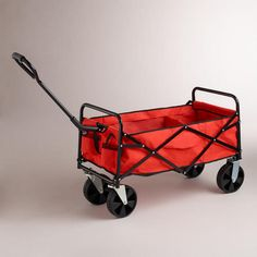 WorldMarket.com: Spicy Orange Rolling Beach Cart  - Must have for rolling our groceries and stuff into the houseboat. :-)