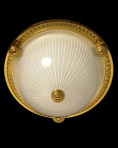 Marvin Alexander,Inc. Gilded bronze and ribbed glass flushmount with button, one light.