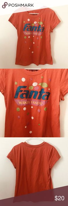 WANTA FANTA Orange Soda Pop Tee Shirt Juniors XL Junior's Coca-Cola Brand Tee Shirt  WANTA FANTA?  Size: XL 15/17  Measurements In Inches: Across the Chest: 19 Length: 23  Very good, clean condition with no rips or stains!  Clothing measurements are taken in inches with the garment laying on a flat surface. Across the Chest is from under one arm to the other. Body Length is from the collar seam to the hem. Sleeve is from shoulder seam to the cuff; if no seam, measurement is from the collar…
