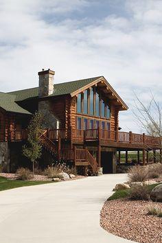 log cabin home. I love the balcony!