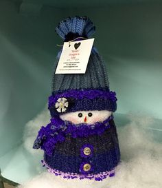 A personal favorite from my Etsy shop https://www.etsy.com/listing/257224086/single-sock-snowman-in-purple-and-blue
