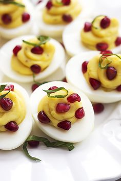 Easy Basil Pomegranate Deviled Eggs - take your traditional deviled eggs to a whole new level with this easy-to-follow recipe!