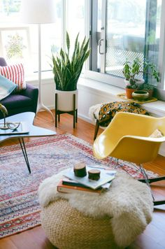 """Besides loving the pouf and bright yellow chair, the """"snake plant"""" is a good chi enhancement by helping purify indoor air."""
