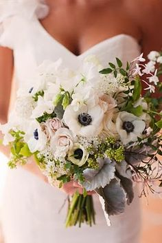 This beautiful bouquet just ties everything together perfectly. The natural greens along with some peachy/pink and the deep blue/black of the white flowers would go so beautifully with the wedding and bridesmaid dresses.