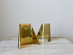 // Ben Seibel Bookends   I want some polished bookends, simple like these. My furnishings need some shiny.