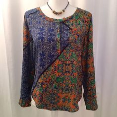 Anthropologie Plenty by Tracy Reese top S/P Plenty by Tracy Reese top from Anthro. Worn only a few times and still in excellent condition. Tag says size P but I think it would fit an XS-S perfectly. The sleeves have a snap tab on them so they can be worn rolled up or full length. Anthropologie Tops Tees - Long Sleeve