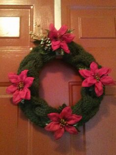 Hand knitted wreath with poinsettias by TheKnitBrit on Etsy