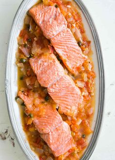 Quick, easy, healthy! Salmon fillets poached in a tomato onion caper sauce with white wine. Healthy, easy 1-pot midweek dinner!