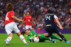Hope Solo #1 of the United States makes a save against Japan during the Women's Football gold medal match on Day 13 of the London 2012 Olympic Games at Wembley Stadium on August 9, 2012 in London, England.