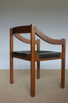 Jean Gillon; Rosewood and Leather Armchair for Italma, 1960s.