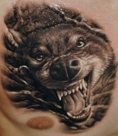 The amount of detail put into the teeth of this tattoo made us recoil in fear that we would get bitten.