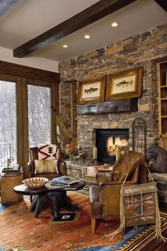 The great room features oak floors, a hand-scraped fireplace mantel and vaulted ceilings with wood beams.