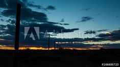 Stock Footage of A static timelapse with a slow pan across a typical Karoo farm landscape with a sheep fence in the foreground as the sun sets behind dramatic clouds, dip to a black silhouette. Explore similar videos at Adobe Stock Sheep Fence, African Sunset, A Typical, Sun Sets, Black Silhouette, Windmill, Geology, Stock Video, Stock Footage