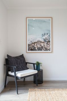 The simple lines of this chair and the light tones of the wall art give a mid-century modern feel to the corner of this living room, combined with a modern cushion and simple plant for decoration. #midcenturymodern #livingroomdecor #wallart #livingroom #generationhomesnz #totaraplan #cosycorner Modern Cushions, 4 Bedroom House Plans, Cosy Corner, Simple Lines, Midcentury Modern, Home Interior Design, Living Room Decor, Mid Century, Plant