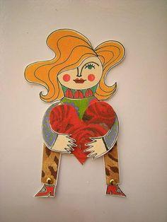 Maria é uma menina muito corajosa. Ela é decidida e independente, mas é muito romântico também! <br>Ela literalmente tem um imenso coração! <br>Ela é impressa a partir de uma ilustração original minha. <br>Maria é um ímã articulado, que além de decorar sua geladeira pode ser emoldurado para decorar sua casa como um quadro, além de ser um ótimo marcador de livros :) <br>Ela é impressa em papel 200g <br> <br>*LOJISTA: ESCREVA-ME PARA SABER PREÇOS ESPECIAIS
