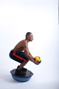 """Looking for a great exercise that works your legs and your core ( Abs/lower back area) add the """"Bosu Body weight Squat Toss & Catch"""" to your workout! Stand on the flat side of a Bosu while holding a medicine ball at waist level. Squat until your knees are at a 90 degree angle. As you rise, toss the ball in the air! That is one rep. For more nutrition, exercise and sleep tips check out my YOUTUBE Channel at sloanluckie.com."""