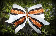 white orange and black cheer bow.  See more on Facebook at Ribbons and Bows Oh My or on our website at ribbonsandbowsohmy.wix.com