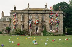 Eglingham Hall with Balloons  Northumberland, UK  Italian Vogue September 2000  TIM WALKER