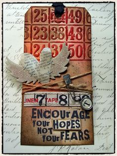 Grunged Bingo Card Tag...with stapled heart & wings.