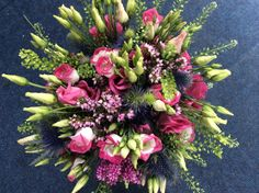 Lovely handtied of pink and white eustoma, with thalaspi fern and a Scottish feel with the thistles and purple heather
