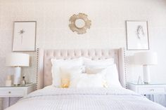 Symmetry between the nightstands, lamps, and paintings on the wall all give this bedroom a pulled-together, hotel vibe.