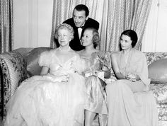 In a 1936 photograph, Elsie de Wolfe (far left) sits next to actress and opera star Grace Moore at a party at Pickfair, the home of Mary Pickford. Joining them are Moore's husband, actor Valentín Parera, and Princess Vasili Romanov.