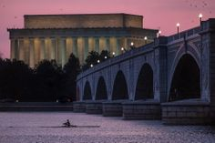 Twilight in D.C.:  A rower skims across the Potomac River in Washington, D.C. (AP Photo/J. David Ake) The Week