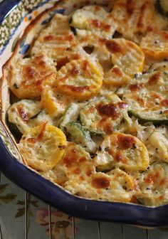 Zucchini and Squash Au Gratin: 2 tbsp. Butter 1 large Zucchini 1 large Squash 2 Shallots 1 tsp. garlic ½ cup heavy cream Shredded Cheese ( mozzarella or provolone works best.) Salt/Pepper Oregano Parmesan cheese - foodandsome